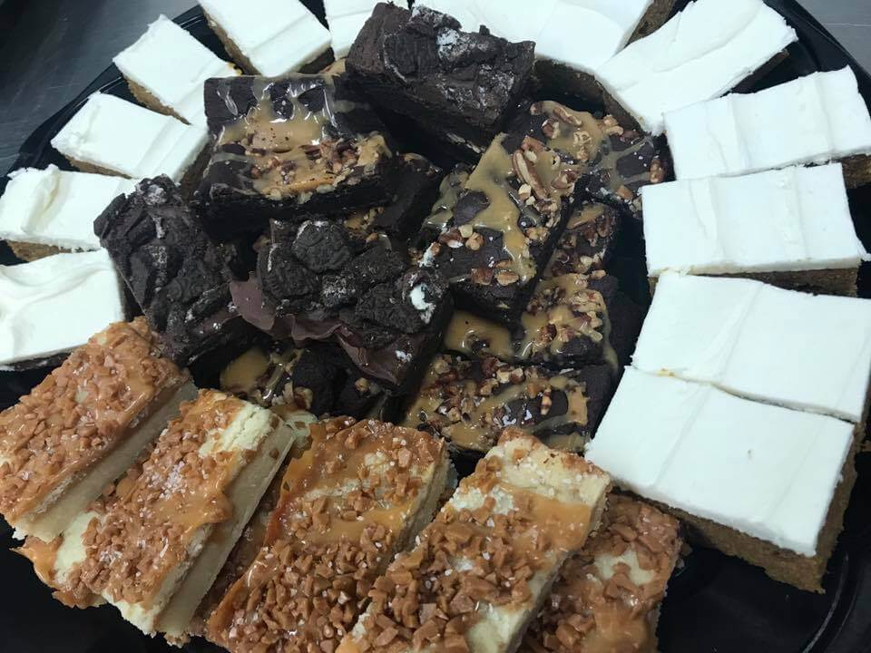 display of bars and brownies on plate