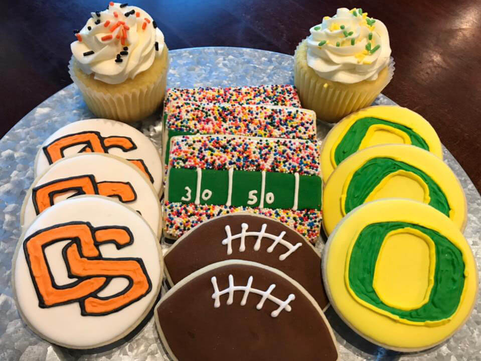 football teams decorated cookies on a plate