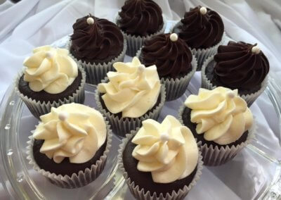cupcakes on a plate white and chocolate frosting