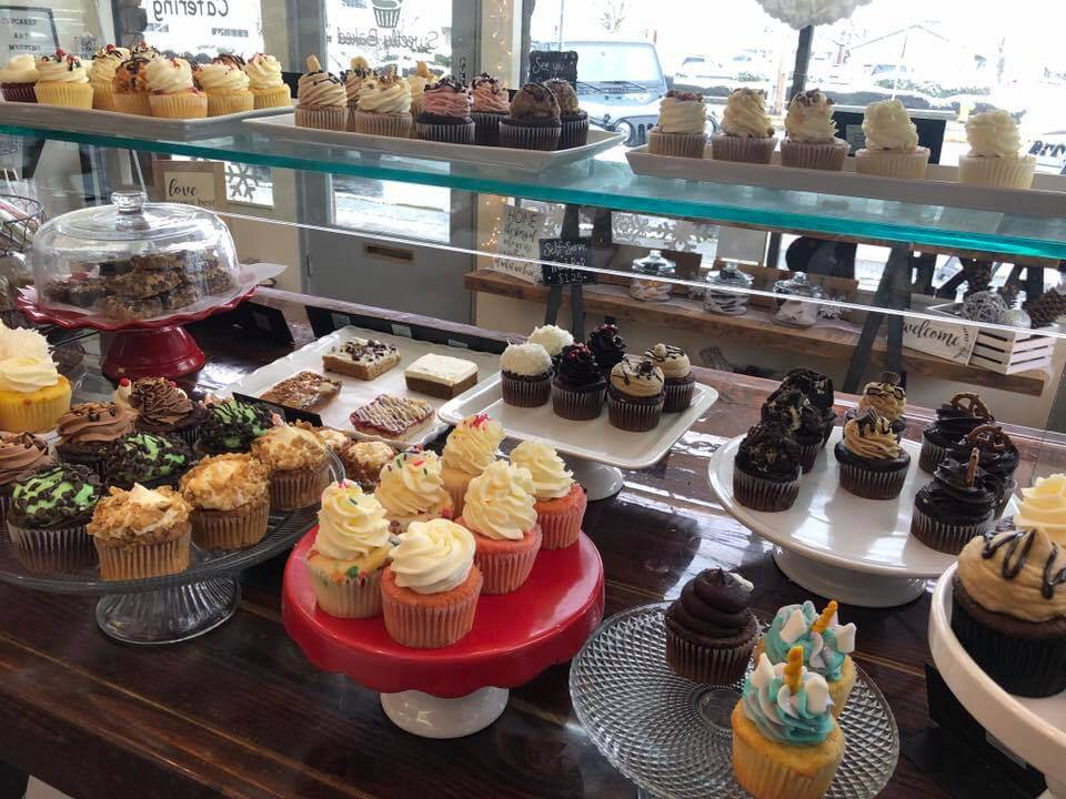 bakery display of cakes, cupcakes and bars